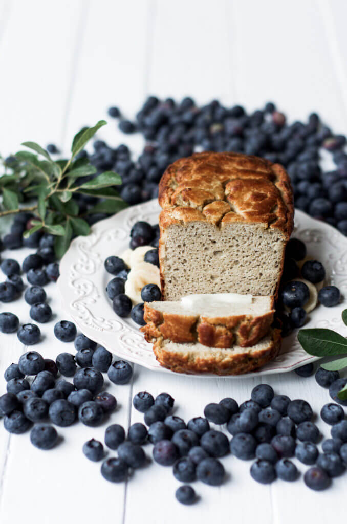 This Grain Free & Paleo Banana Bread is incredibly easy to make and it's made in a blender! Light and airy bread with a delicious crust, this banana bread only takes 5 minutes to whip up and then it's in the oven.