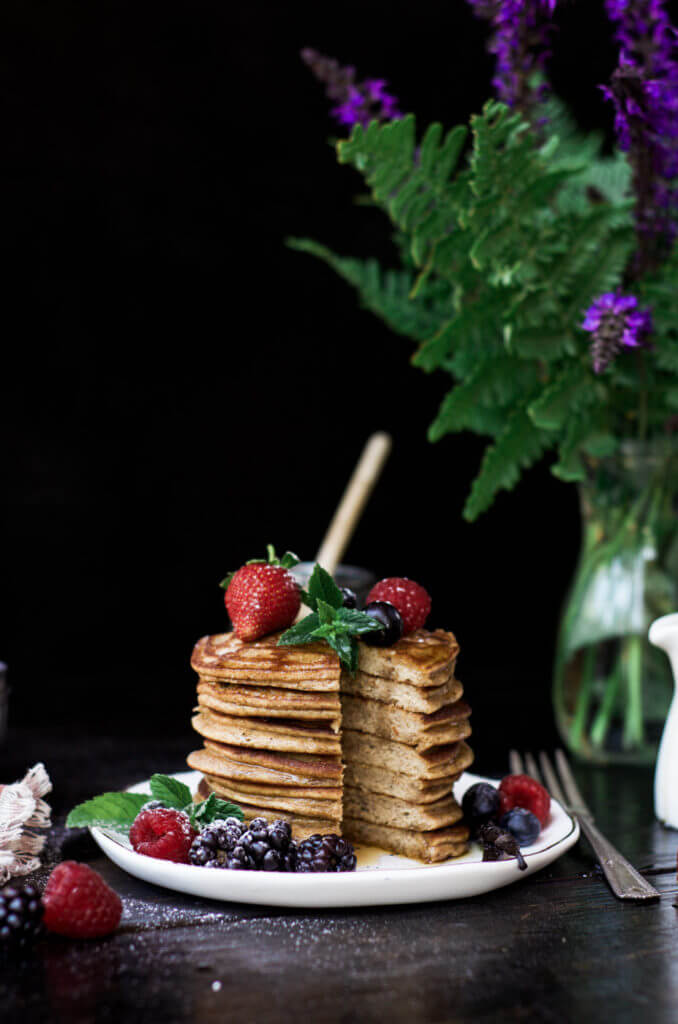 Paleo pancakes made with only four ingredients! These soft and flavorful grain free pancakes are so addictingly delicious and easy to make. The rich and tasty flavors from these pancakes are perfect paired with fresh juicy berries and a drizzle of maple syrup.