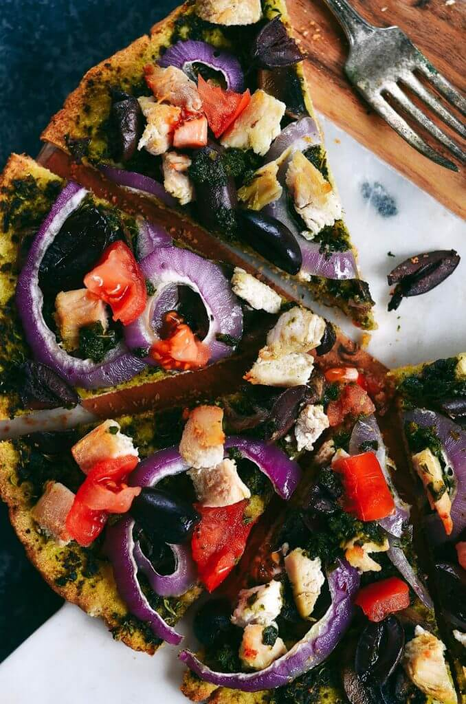 Best and easiest 20 minute no rise paleo pizza! Topped with chicken breast, olives, pesto. Best easy gluten free pizza crust. Best paleo pizza crust. Easy paleo pizza crust. Paleo pizzas. Best gluten free chicken pizza. Top healthy pizza.