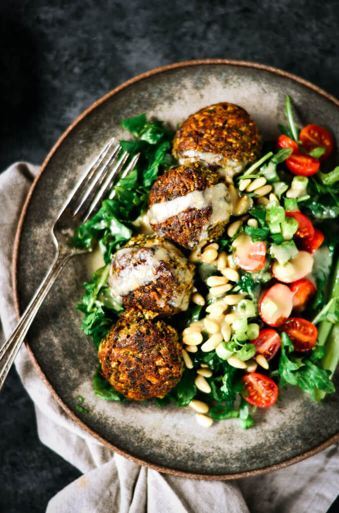 These warm flavorful falafels are better than the real deal! Packed with cauliflower and fresh herbs! A low carb delicious whole30 meal that is easily made in a blender. Easy baked falafel recipe. Best paleo falafel recipes. Falafel sauce. Healthy falafel. Easy whole30 cauliflower falafel. Made in 15 minutes! Paleo, healthy, and easy to make! Easy whole30 dinner recipes. Whole30 recipes. Whole30 lunch. Whole30 recipes just for you. Whole30 meal planning. Whole30 meal prep. Healthy paleo meals. Healthy Whole30 recipes. Easy Whole30 recipes