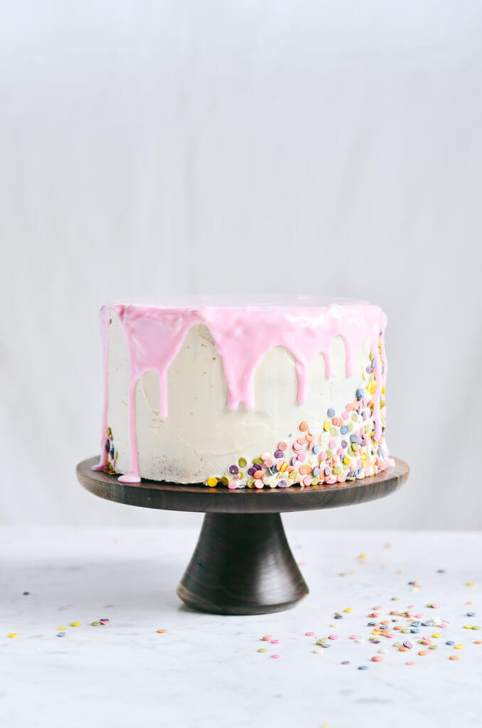 What's the secret ingredient?… This grain free funfetti cake is filled with natural root vegetable colored sprinkles white chia seeds! To top it off, it's covered in a creamy and smooth coconut oil frosting and pink glaze. Naturally gluten free, dairy free, and dye free. Homemade funfetti cake mix recipe. Funfetti cake box mix. Funfetti cake ideas. Funfetti cake decoration ideas. Funfetti birthday cake. Gluten free funfetti cake recipe. Funfetti gluten free sprinkles. Healthy funfetti cake. Healthy gluten free funfetti birthday cake. Vegan frosting. Vegan funfetti frosting. Paleo funfetti cake. Grain free funfetti cake. Easy funfetti cake.