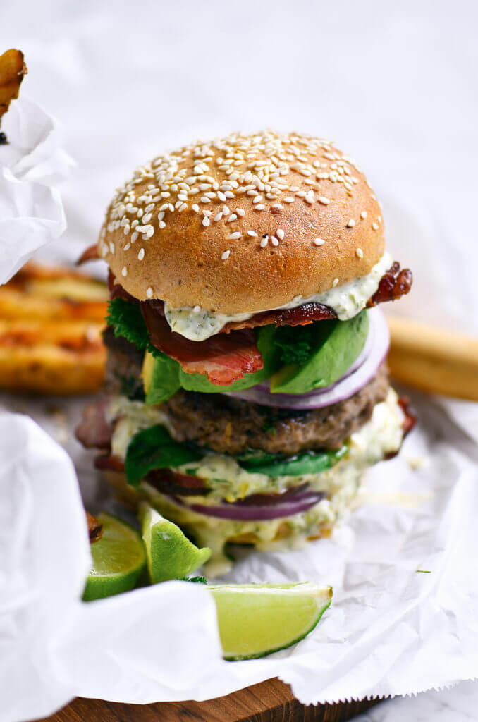 The most delicious LEGIT Paleo bacon avocado burgers! Loaded with fresh basil and garlic. Topped with a creamy white sauce and red onion. Plus, these fluffy and soft grain free buns are to die for! Check out the whole30 burger option too! Paleo burger recipe. Paleo burger patties. Paleo beef burgers. Paleo meal plan. Easy paleo dinner recipes. Easy whole30 dinner recipes. Whole30 recipes. Whole30 lunch. Whole30 meal planning. Whole30 meal prep. Healthy paleo meals. Healthy Whole30 recipes. Easy Whole30 recipes.