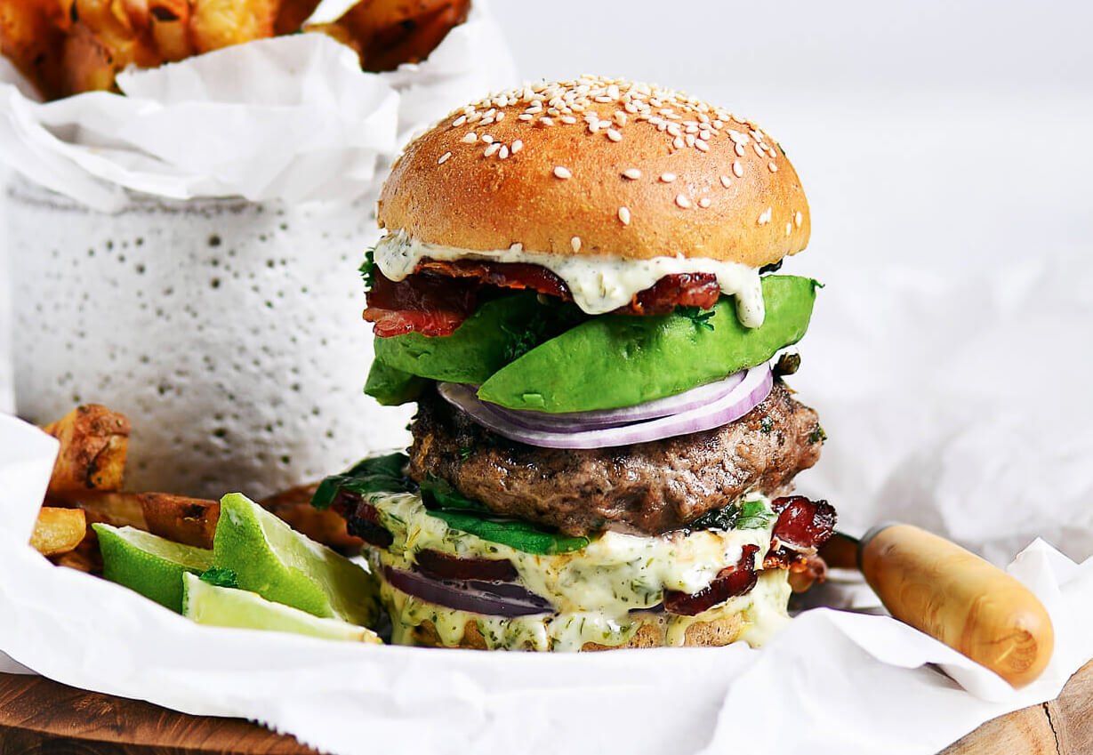 LEGIT Paleo bacon avocado burgers! Loaded with fresh basil and garlic. Topped with a creamy white sauce and red onion. Plus, these fluffy and soft grain free buns are to die for! Check out the whole30 burger option too! Paleo burger recipe. Paleo burger patties. Paleo beef burgers. Paleo meal plan. Easy paleo dinner recipes. Easy whole30 dinner recipes. Whole30 recipes. Whole30 lunch. Whole30 meal planning. Whole30 meal prep. Healthy paleo meals. Healthy Whole30 recipes. Easy Whole30 recipes.
