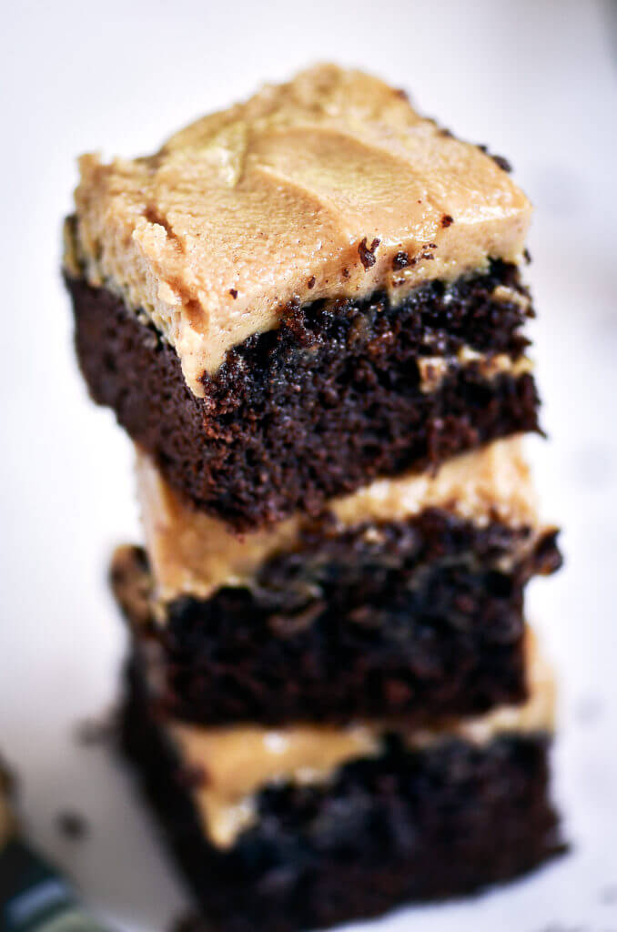 Ready for some chocolate goodness?! The best healthy paleo coconut flour brownies topped with a smooth and creamy peanut butter frosting (almond butter for paleoers). Each brownie has 16g protein! Best gluten free brownies. Best paleo brownies recipe. Fudgey paleo brownie recipe. Fudgey chocolate brownies. Healthy brownie recipe. Easy paleo brownies.