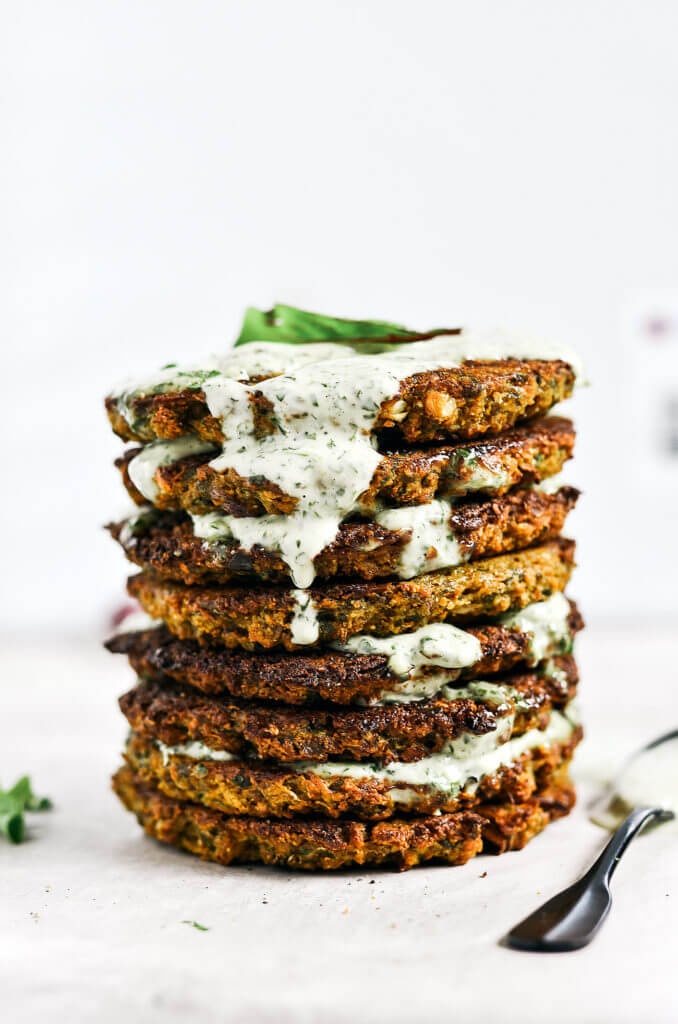 Crispy baked whole30 cauliflower patties with a delicious creamy cilantro garlic sauce. Easy paleo and whole30 recipe for lunch, dinner, and even breakfast if you're like me! whole30 meal plan. Easy whole30 dinner recipes. Easy whole30 dinner recipes. Whole30 recipes. Whole30 lunch. Whole30 meal planning. Whole30 meal prep. Healthy paleo meals. Healthy Whole30 recipes. Easy Whole30 recipes. Easy whole30 dinner recipes. Healthy breakfast recipes. Cauliflower pancake recipe. Easy cauliflower whole30 recipes. Paleo pancake recipe. Easy paleo dinner recipes.