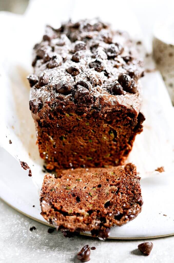 This paleo chocolate zucchini bread is soft, light, and moist, plus gluten free! It's ready for baking in 5 minutes! Easy to whip up in the food processor. Freezer friendly and a crowd pleaser! Easy paleo diet recipes. Best gluten free bread. Easy paleo bread recipe. Best paleo zucchini bread recipe. Easy gluten free zucchini bread. Best gluten free zucchini bread.