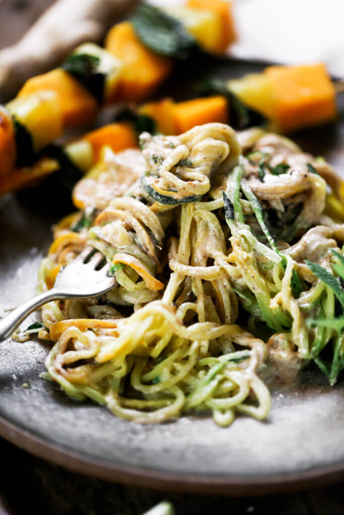 Low carb whole30 sesame ginger zucchini noodles with grilled pineapple, mango, and mint! Fresh, healthy, and low calorie dinner recipe loaded with healthy fats and my new favorite creamy sesame ginger sauce.whole30 meal plan. Easy whole30 dinner recipes. Easy whole30 dinner recipes. Whole30 recipes. Whole30 lunch. Whole30 meal planning. Whole30 meal prep. Healthy paleo meals. Healthy Whole30 recipes. Easy Whole30 recipes. Easy whole30 dinner recipes. Zucchini noodle recipe. Best veggie noodle recipes. paleo dinner recipes. best asian noodles. easy asian noodles.