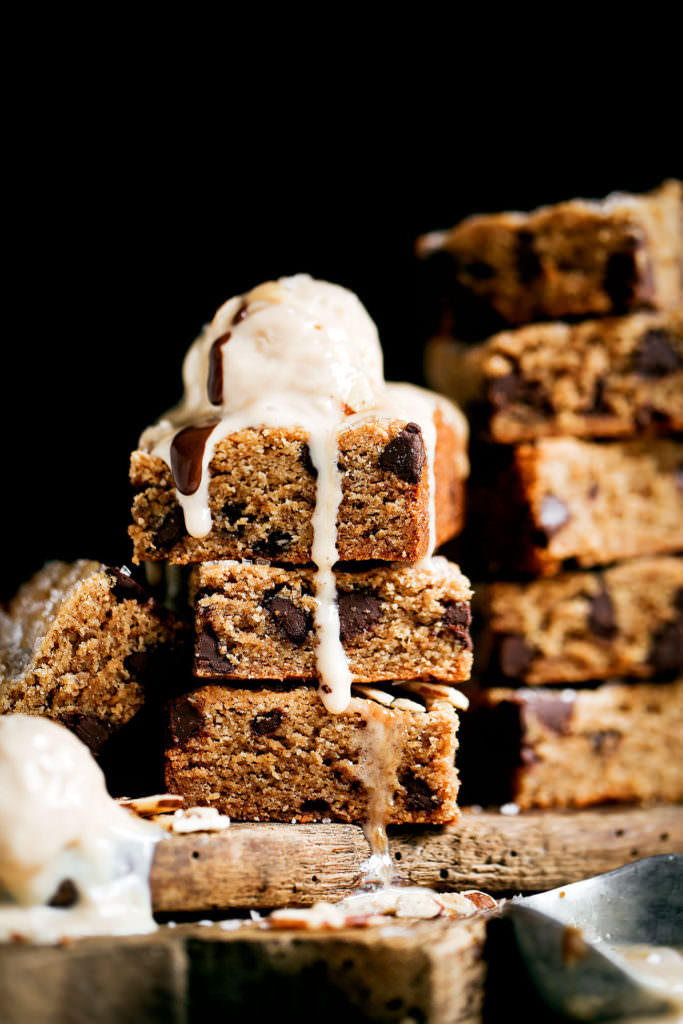 The best soft and chewy paleo blondies! Gluten free, low in sugar (1/4 cup coconut sugar in the whole batch!), and vegan. This recipe can be made ahead and stored in the freezer. It's also safe for raw cookie dough eating. Yum! Easy paleo baking. Maple syrup blondies. Vegan blondie recipe. low carb paleo blondies. almond butter paleo blondies. Healthy vegan blondies recipes. Gluten free vegan blondies. Easy vegan blondies. Paleo cookie bar. Easy paleo cookies.