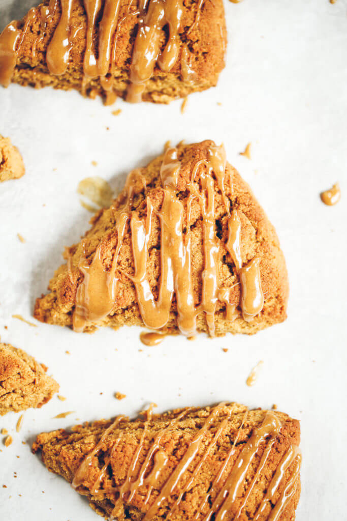 Easy gluten free, paleo pumpkin spice scones with maple glaze. A warm and comforting grain free treat for cosy fall mornings. This grain free pumpkin scone recipe is a family favorite. If you love scones as much as I do, then today is gonna be a good day for you! Easy gluten free scones Gluten free pumpkin scones. Paleo pumpkin scones. Paleo vegan pumpkin scones. Easy paleo pumpkin scones. Starbucks copy cat pumpkin scones. Healthy gluten free scones.