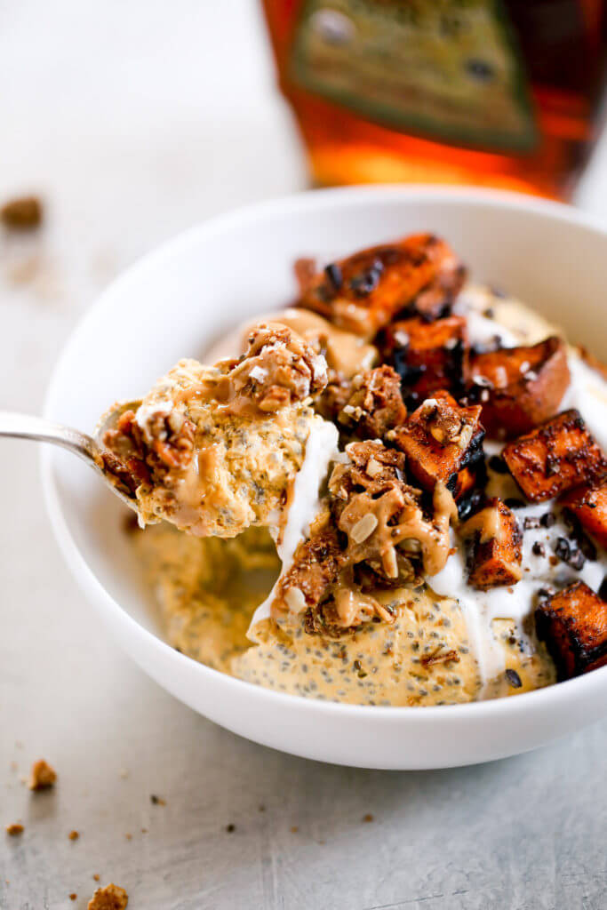 I'm OBSESSED with this Thick, creamy, coconut yogurt pumpkin chia breakfast! What an easy paleo breakfast idea! A bowl full of creamy pumpkin spice pudding, topped with roasted sweet potatoes and nut butter! Ready in just 3 minutes, free of added sugar, Paleo, dairy free, and gluten free. Just as delicious for a snack as it is for breakfast!