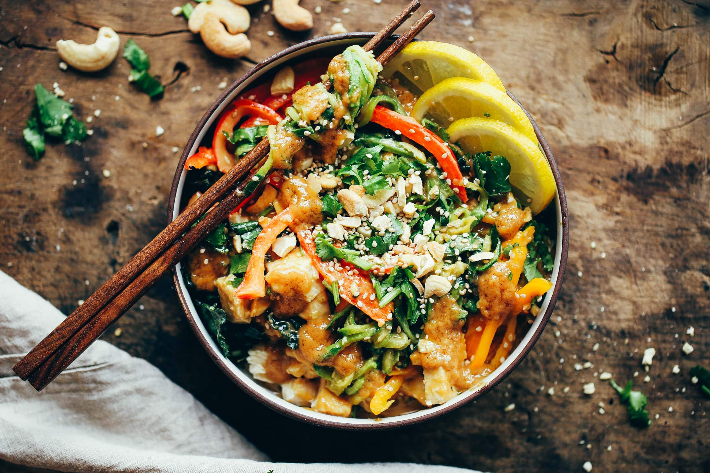 "15 Minute whole30 Thai chicken noodles with ""peanut"" sauce, kale, and bell peppers. An easy family friendly meal, serve hot or cold! Easy whole30 dinner recipes. Whole30 recipes. Whole30 lunch. Whole30 recipes just for you. Whole30 meal planning. Whole30 meal prep. Healthy paleo meals. Healthy Whole30 recipes. Easy Whole30 recipes. Zucchini Noodle recipes."