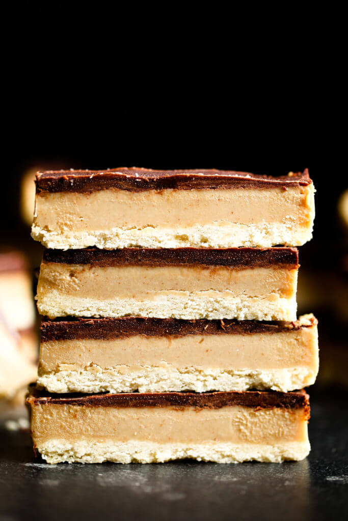 Make these healthy paleo Twix bars at home! You won't be able to tell the difference between these copycat candy bars and the popular original. Game changer: this recipe for healthy homemade paleo Twix candy bars. They are paleo, gluten free, sugar free, and vegan. Healthy homemade Twix bar recipe. Homemade paleo Twix candy bars. Homemade Twix bars. Healthy candy recipe. Homemade paleo candy. Homemade paleo chocolate candy. Easy paleo wit bars. Easy best homemade Twix bars.