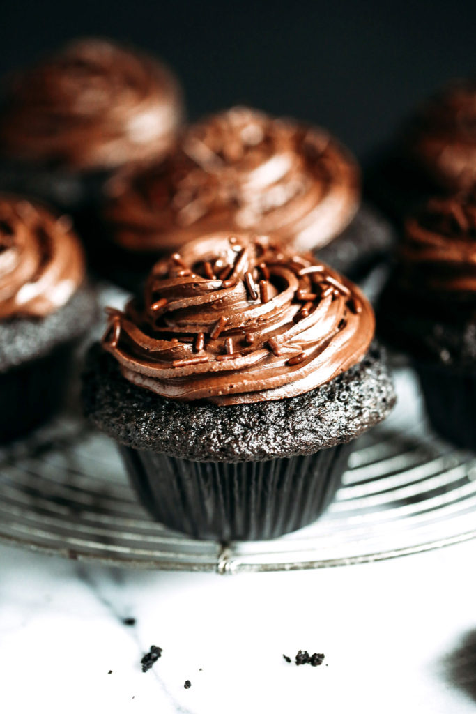 Paleo chocolate cupcakes-moist, but not eggy! These paleo cupcakes have a rich, dark chocolate taste and are covered in a whipped dairy free refined sugar free chocolate frosting! Coconut flour cupcakes. Best easy Paleo cupcakes. Paleo cupcakes recipes. Gluten free chocolate cupcakes. Gluten free coconut flour cupcakes. Dairy free healthy cupcakes. Paleo chocolate frosting.
