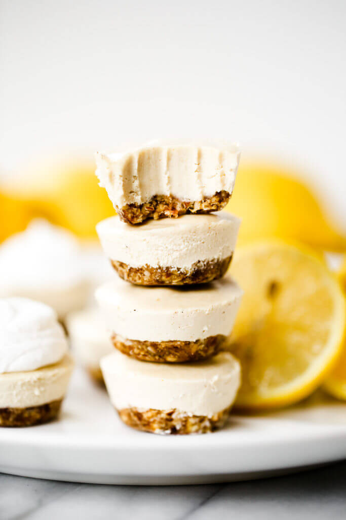 No-bake lemon cheesecake bites made in the blender! (Paleo + vegan). Thick creamy cashew cheesecake lemon layer with nut and date crust. Bite-size made quickly in a blender or food processor- chilled before eating! Gluten free, dairy free, refined sugar free. Easy no bake cheesecake recipes. NO Bake cheesecake Filling. Easy vegan cheesecake recipes. Best vegan cheesecake. Easy paleo cheesecake recipes. Dairy free paleo cheesecake. Best raw cheesecake recipes. Easy raw cheesecake.