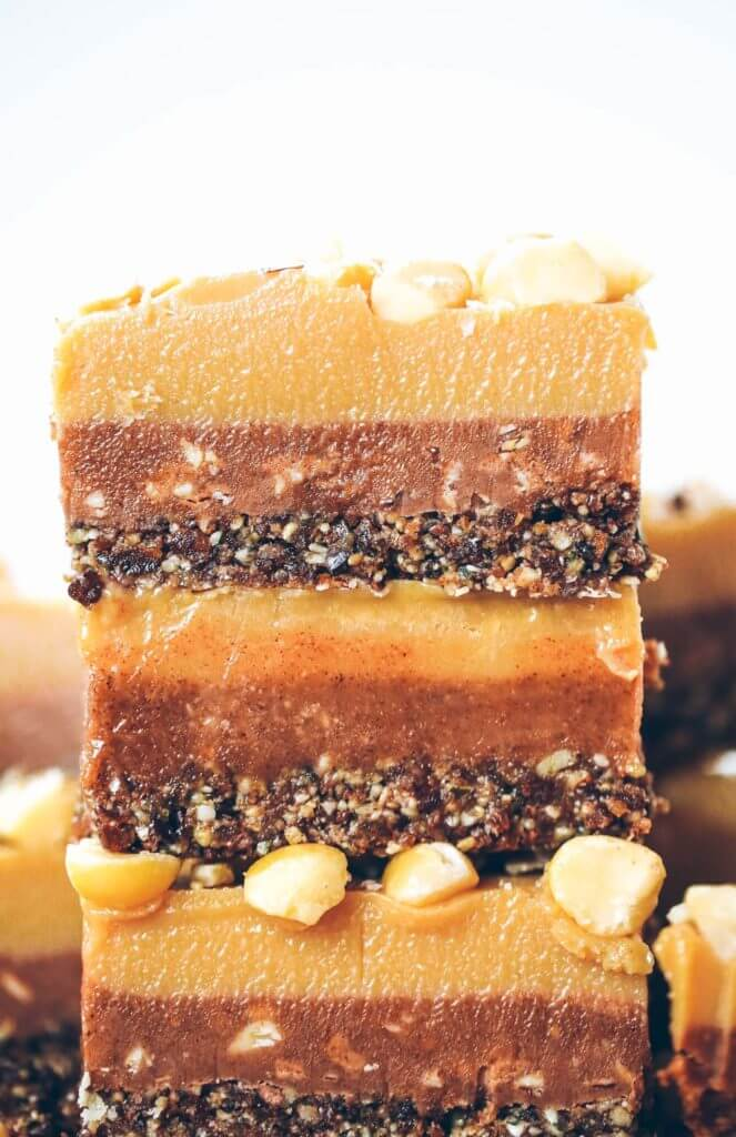 Three layers of coconut oil caramel fudge- refined sugar free, raw, paleo. Layered with tahini + almond butter fudge! Paleo candy recipes. Paleo candy bar. SO easy to make! Tastes like Christmas candy, but it's sugar free, paleo, and raw! Paleo candy pecans. Low carb candy. Healthy candy recipes. Paleo caramel. Easy healthy paleo caramel. Paleo fudge. Easy almond butter fudge. Tahini fudge. Healthy dairy free fudge recipes. Coconut oil fudge.