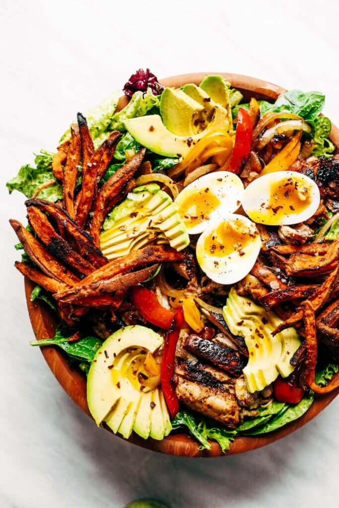Grilled Garlic Lime Chicken Fajita Salad loaded with crispy sweet potato fries, grilled chicken, and topped with creamy avocado dressing made in the blender! Paleo, whole30, and makes for easy meal prep! Whole30 meal plan that's quick and healthy! Whole30 recipes just for you. Whole30 meal planning. Whole30 meal prep. Healthy paleo meals. Healthy Whole30 recipes. Easy Whole30 recipes. Best paleo dinner recipes.