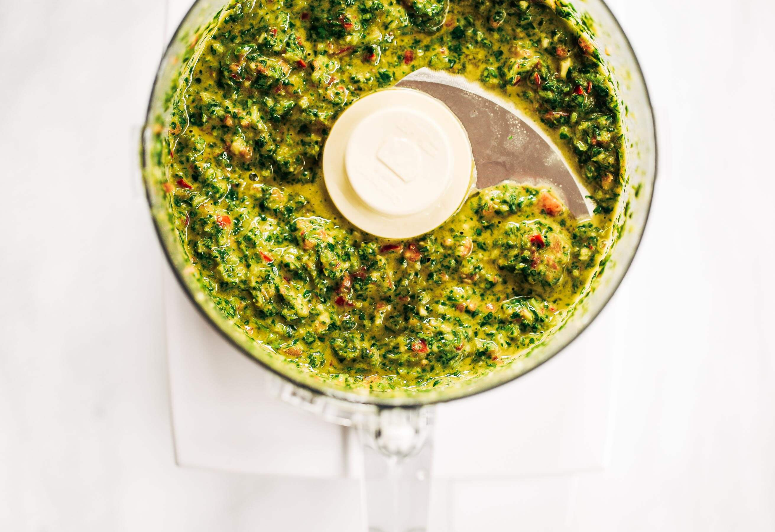 Zesty, fresh, and flavorful, cilantro garlic chimichurri with jalapeno pepper. Perfect for marinating chicken, beef, or topping off sweet potato fries and salads! Made easy in the blender in five minutes. Paleo, gluten free, and whole30 friendly. Easy whole30 dinner recipes. Whole30 recipes. Whole30 lunch. Whole30 recipes just for you. Whole30 meal planning. Whole30 meal prep. Healthy paleo meals. Healthy Whole30 recipes. Easy Whole30 recipes