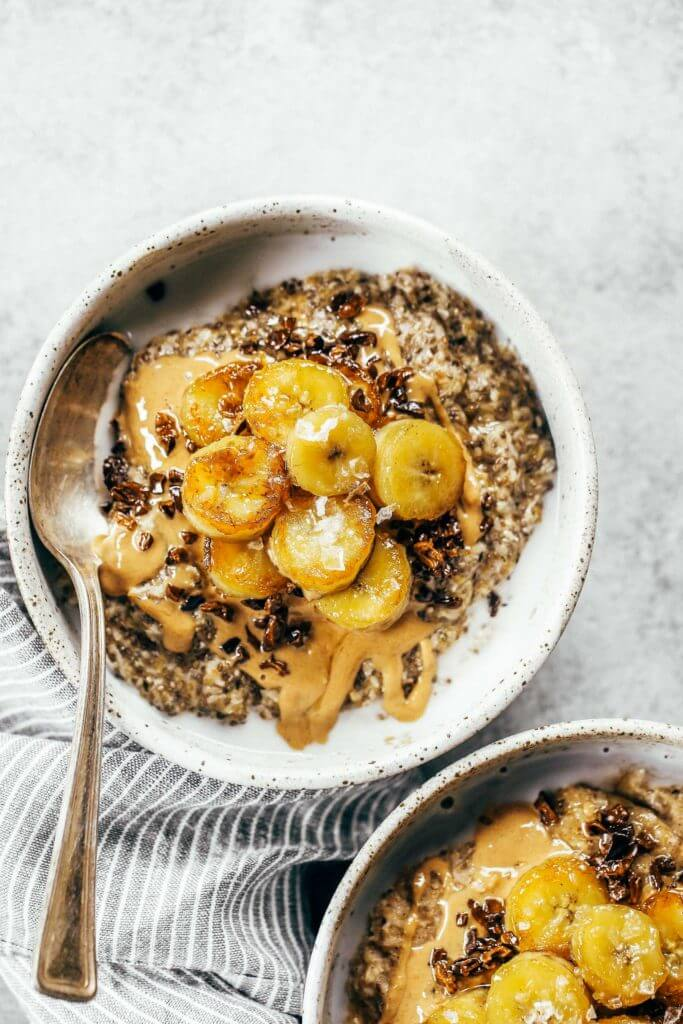 Warm and toasty Paleo banana cereal. Made with caramelized bananas, chia seeds, golden flax, hemp, and coconut. This grain free cereal tastes like oatmeal and is topped with my favorite caramelized bananas! Paleo, gluten free, healthy. Whole30 breakfast recipe. Easy paleo breakfast ideas. Whole30 breakfast ideas. paleo cereal recipe. whole30 meal plan.h. Whole30 meal planning. Whole30 meal prep. Healthy paleo meals. Healthy Whole30 recipes. Easy Whole30 recipes.