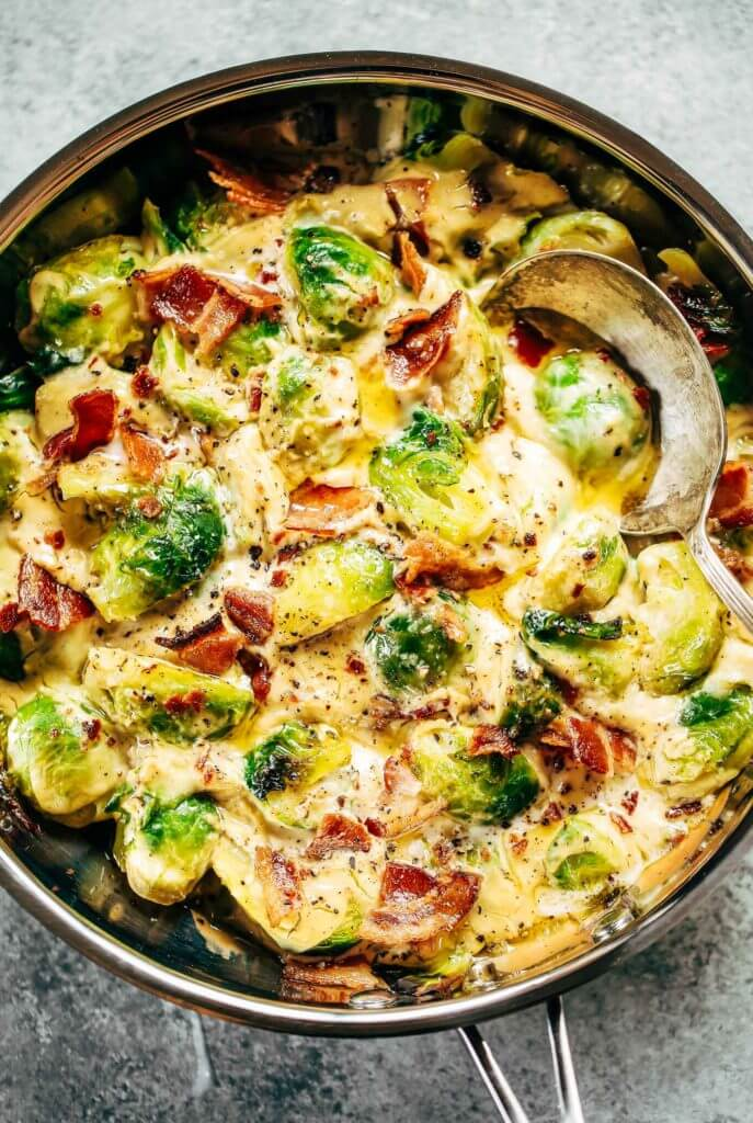 Creamy bacon brussel sprouts in cauliflower cream sauce! This dish is outstanding all on it's own or can be paired with another side of greens. It's a family favorite! Gluten free, dairy free, paleo, and whole30. Easy whole30 dinner recipes. Whole30 recipes. Whole30 lunch. Whole30 recipes just for you. Whole30 meal planning. Whole30 meal prep. Healthy paleo meals. Healthy Whole30 recipes. Easy Whole30 recipes.