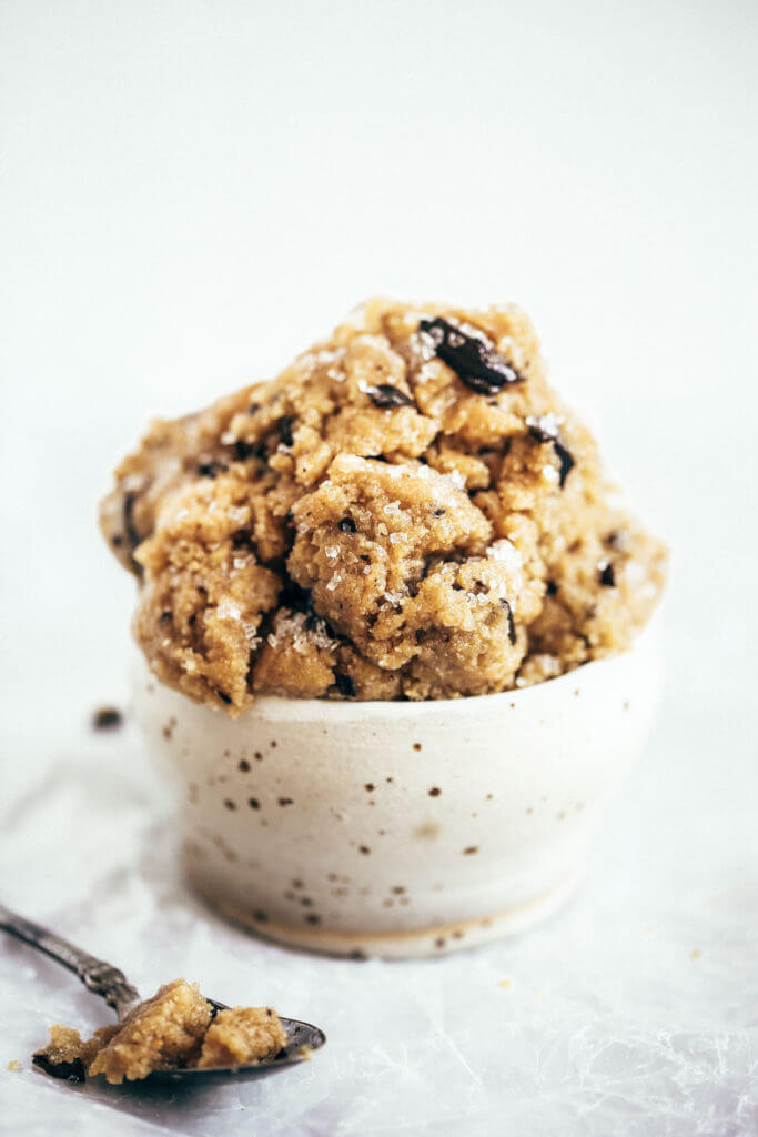Healthy paleo cookie dough that's safe to eat raw! This cookie dough is gluten free, dairy free, and made without refined sugars. Ready in just five minutes! Paleo cookies no egg. Easy paleo cookie recipes. No bake paleo cookies. Healthy paleo cookies. Easy paleo snacks for on the go. Almond paleo cookies. best paleo cookie dough.