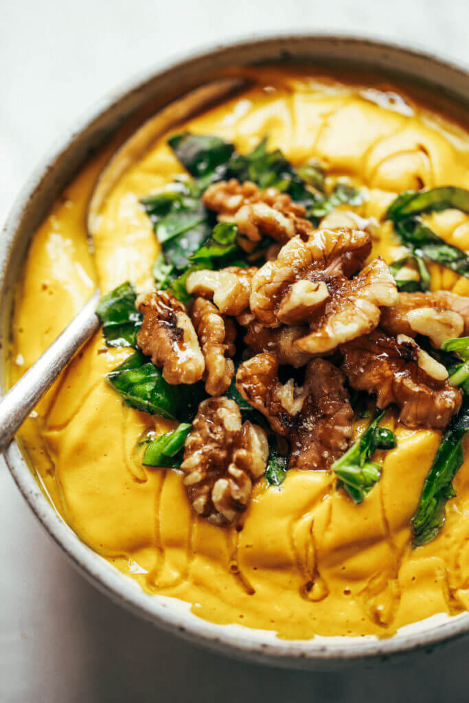 Creamy golden turmeric vegetable soup; made with vegetables, cashews, and curry spices! A warm and comforting paleo whole30 dinner recipe, full of rich earthy flavors. Whole30 easy recipes. Easy whole30 dinners. Whole30 trader joes recipes. Whole30 dinner meal planning. Easy whole30 soup. Paleo for beginners. Paleo diet recipes. Paleo dinner ideas.