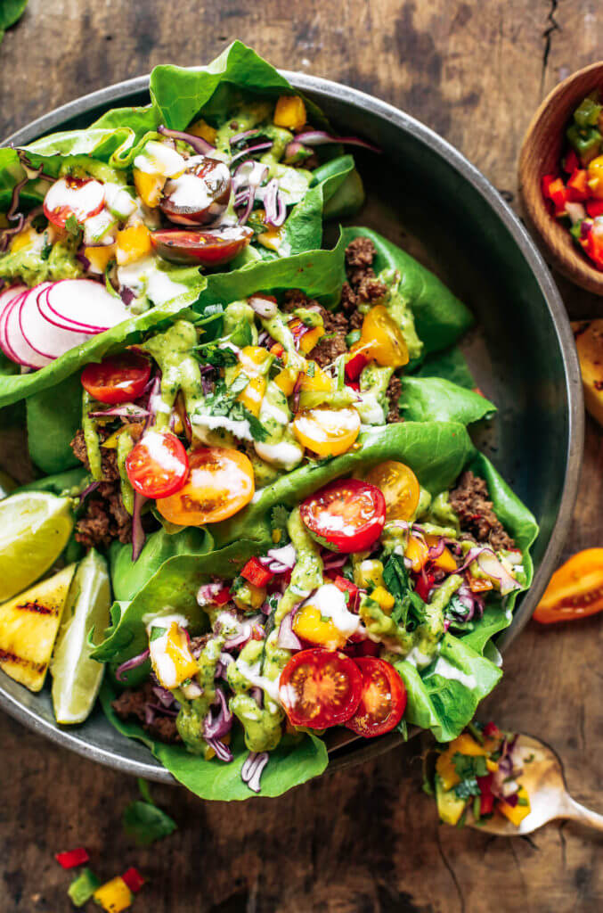 Crowd pleaser dinner: whole30 lettuce tacos with mango salsa! Swap the tortilla for a healthy crisp lettuce leaf and you have yourself a drool-worthy dinner, complete with mango avocado lime salsa. An easy paleo meal for family dinners, meal prep, or on-the-go! Easy whole30 recipes. Easy whole30 trader joes dinner. Easy whole30 dinner meal planning. Easy paleo tacos.
