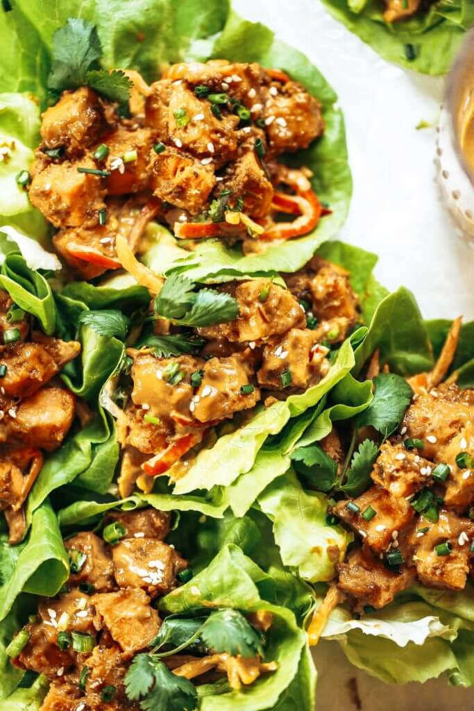 "Whole30 lunch idea: these drool worthy thai lettuce wraps, stuffed with roasted sweet potato, rainbow mango slaw, and the best thai ""peanut"" sauce you ever had. Whole30 lunch easy. Whole30 lunch on the go. Whole30 lunch prep. Whole30 lunch ideas. Whole30 lunch work. Whole30 lunch recipes. Whole30 lunch recipes for work. Whole30 lunch meal planning. Whole30 lunch kids. Quick whole30 lunch recipes. Whole30 lunch salad."