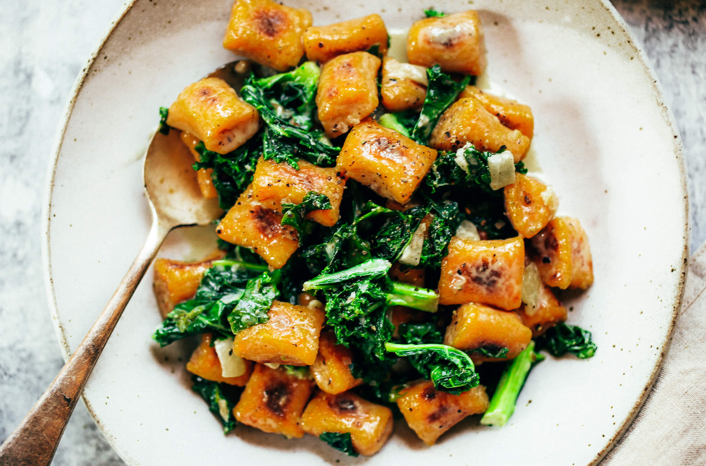 Easy paleo sweet potato gnocchi served with kale sage sauce. Delicious, healthy, family meal. Soft pillowy gnocchi made with sweet potato. Easy whole30 dinner recipes. Easy whole30 dinner recipes. Whole30 recipes. Whole30 lunch. Whole30 meal planning. Whole30 meal prep. Healthy paleo meals. Healthy Whole30 recipes. Easy Whole30 recipes. Easy whole30 dinner recipes.