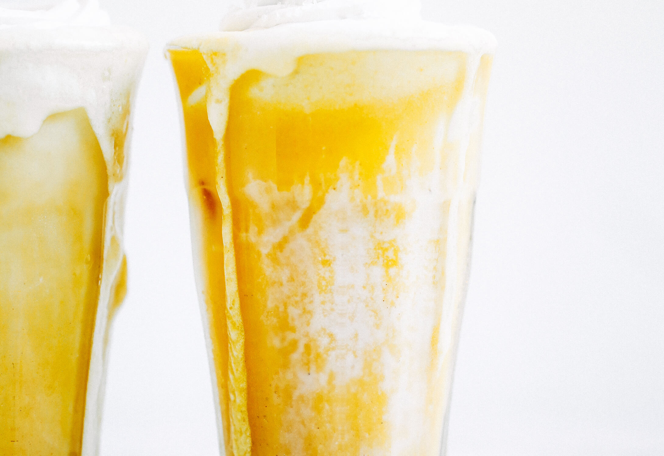 Top on my paleo food list: golden iced turmeric lattes. Tastes like liquid sunshine! An easy refreshing paleo and whole30 beverage, perfect for summer. #paleo #summer #golden Paleo for beginners. Paleo diet recipes. Paleo breakfast on the go. Easy paleo snacks. Best golden milk latte. Whole30 breakfast recipes. Whole30 rules. Whole30 snacks.