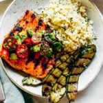 Lemony thyme grilled salmon with cauliflower rice and grilled zucchini. A healthy, light, and fresh whole30 dinner idea! An easy paleo meal for the whole family. Paleo dinner and lunch recipes. Easy paleo diet recipes. Whole30 lunch salad. Whole30 dinner recipes. Whole30 meal prep and sides. Best healthy summer dinner recipes. Grilled salmon recipes.