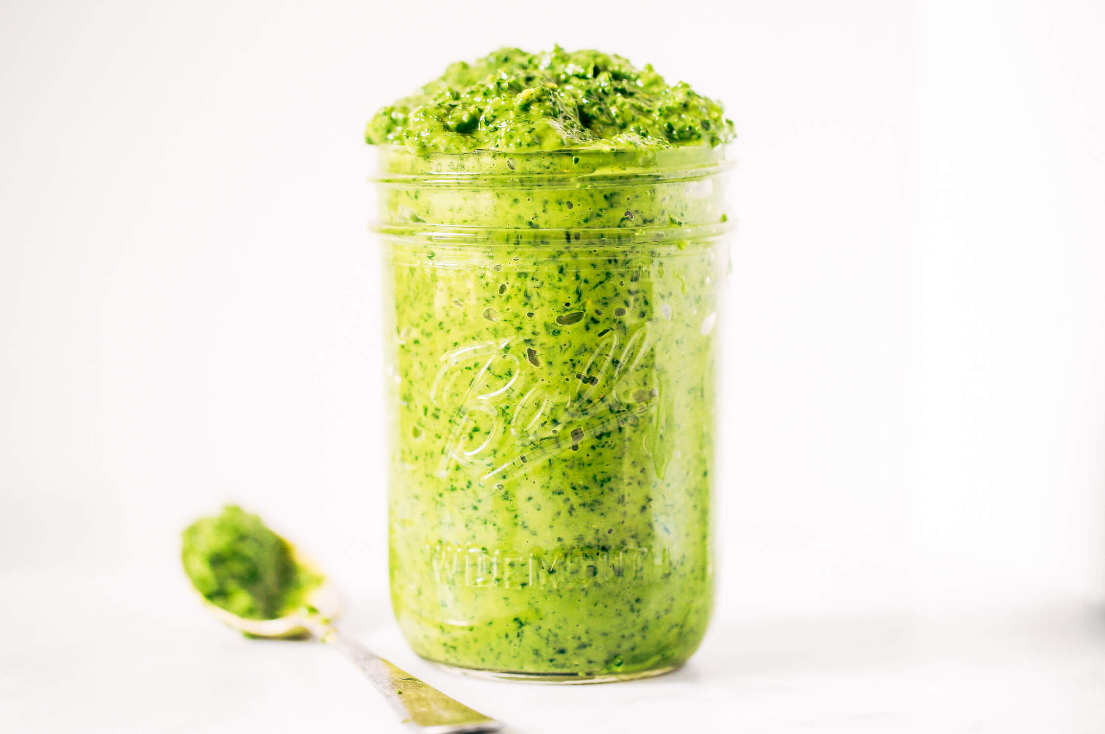 5 minute vegan kale pesto made with avocado, olive oil, and garlic. An easy paleo whole30 sauce to serve with pasta, veggie sticks, or eat with a spoon! A healthy, light, and fresh sauce. Easy whole30 pesto. paleo pesto recipe. Dairy free pesto. Best dairy free pesto recipe. Best whole30 pesto recipe.