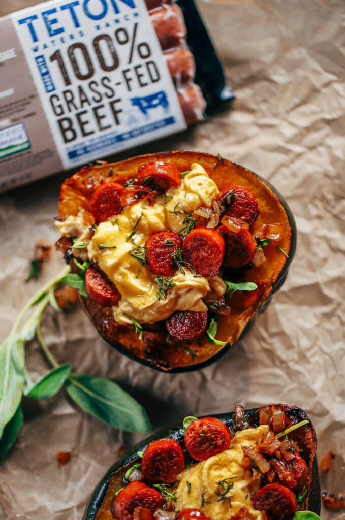 Whole30 breakfast stuffed acorn squash makes a great breakfast, lunch or dinner! Soft scrambled eggs, crispy sausage, sage, and onions all stuffed in a roasted acorn squash makes for easy paleo breakfast meal prep. Best whole30 breakfast recipe for beginners. #whole30 #mealprep #paleo #breakfast #fall
