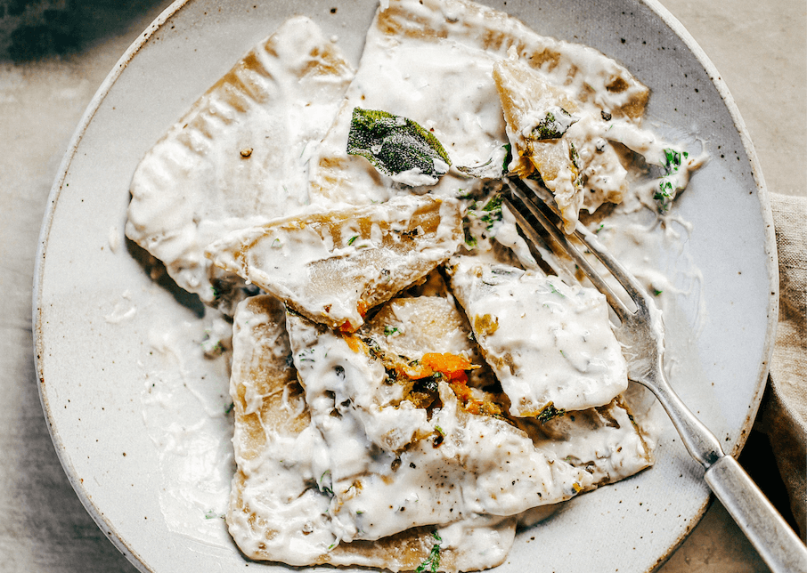 2 Ingredient ravioli made with sweet potato! Filled with butternut kale sage filling and served with cream sauce. A delicious paleo family dinner the whole family will love! Paleo pasta recipe made with white sweet potato. #pasta #paleodiet #healthydinners #mealprep #kale