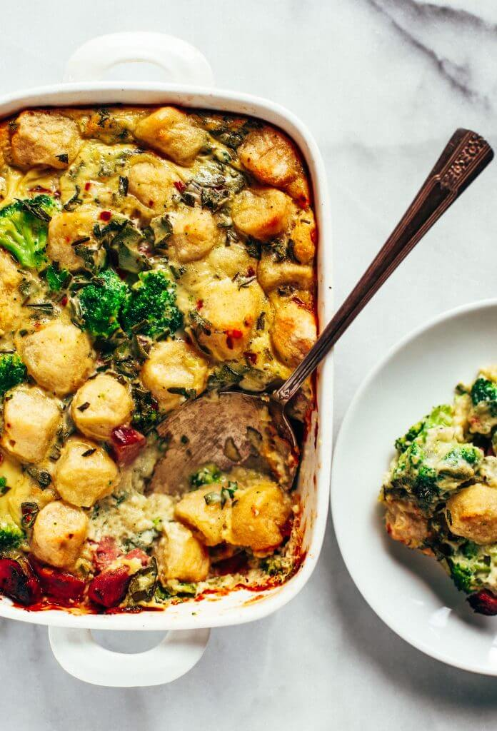 Baked cauliflower gnocchi casserole- made with homemade two ingredient cauliflower gnocchi and rosemary sage cream sauce. Paleo, gluten free, and dairy free family dinner. This casserole is perfect for breakfast or dinner! Easy whole30 dinner recipes. Whole30 meal prep. Best paleo dinners. #paleo