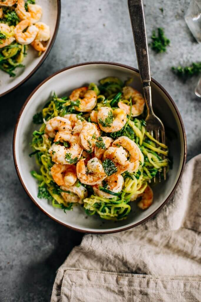 Whole30 zucchini noodles with lemon garlic shrimp. An easy and delicious weeknight dinner. Who's ready for this healthy low calorie and filling paleo dinner? #paleo #whole30 #healthydinner