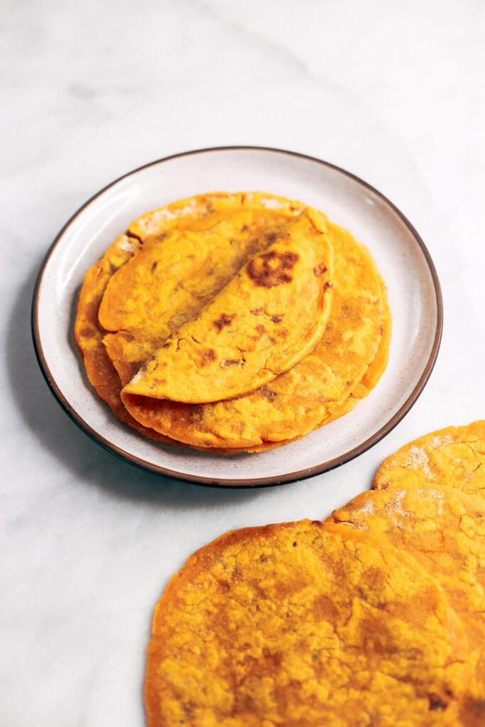 Two ingredient sweet potato paleo tortillas. An easy gluten free and paleo tortilla recipe. These tortillas are pliable, delicious, and easy to make!