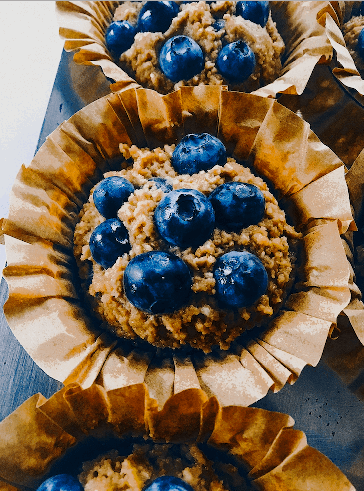 Paleo blueberry muffins made with sweet potatoes instead of flour! These flourless muffins make for a healthy breakfast on-the-go! Kid-proof and delicious paleo breakfast recipe for meal prep. #paleo #baking #recipes #glutenfree #helathy