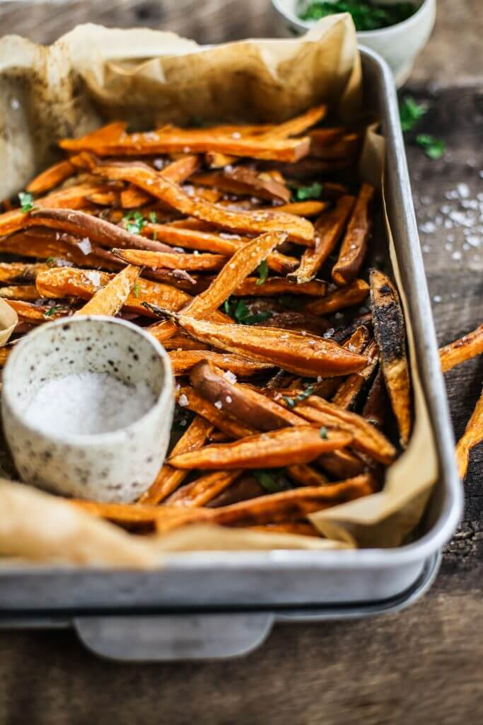 How to make crispy sweet potato fries in 30 minutes! Paleo and whole30 sweet potato fries are a healthy side dish or snack. Make these easy sweet potato fries to serve along a salad or soup. Delicious! Crispy! Easy! #paleo #whole30 #vegan