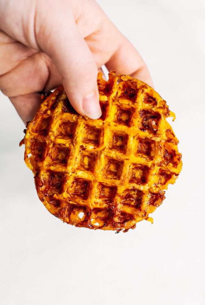 Sweet potato waffles made with two ingredients and ready in just five minutes! These sweet potato waffles are better than Eggos and can be made ahead and frozen for quick meal prep. Best paleo waffles for healthy eaters. Easy gluten free waffles for everyone!