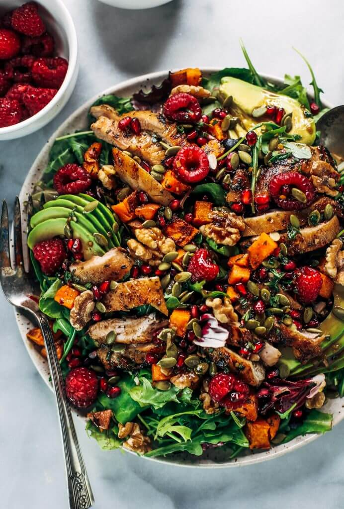 Whole30 harvest chicken salad with roasted rosemary sweet potatoes, avocado, nuts and berries, and homemade balsamic dressing. My favorite salad I eat on repeat! A healthy family dinner for paleo meal prep. #paleo #salad #whole30 #mealprep