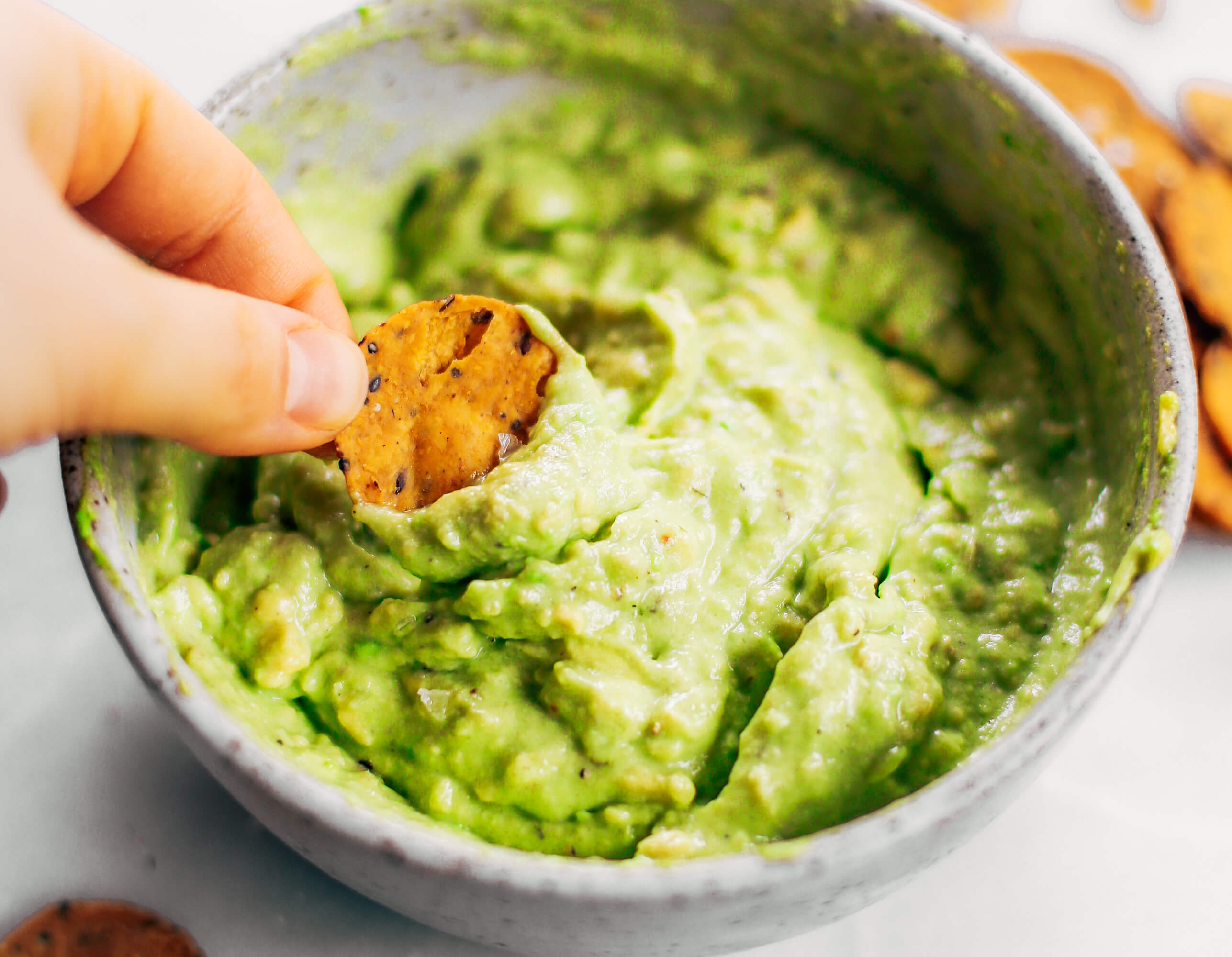 Avocado lime dip ready in two minutes! Vegan avocado guacamole dip, perfect dip for veggie sticks, crackers, and chips. Easy paleo and whole30 side dish. This fresh and tasty avocado dip is a life-changing easy meal prep hack- add it to any dish to upgrade your meal. #avocado #paleo #whole30 #vegan #recipes