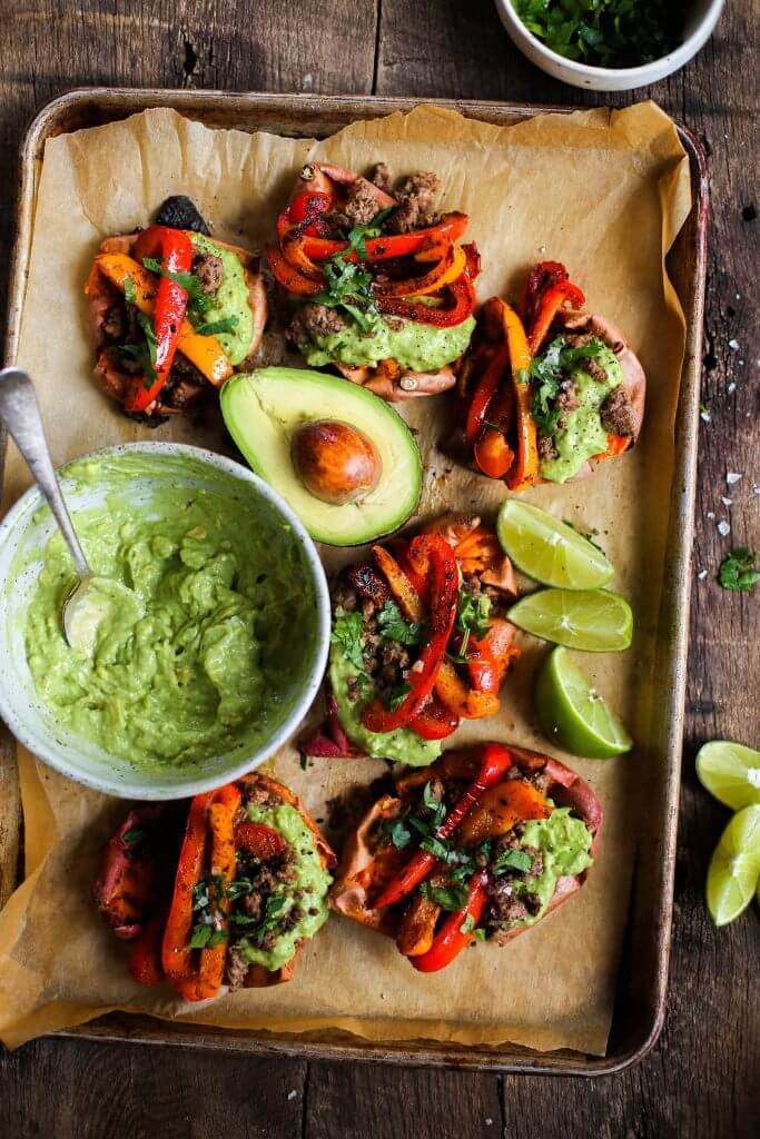 Easy vegan fajita smashed potatoes. This easy whole30 and paleo sheet pan dinner is delicious served with creamy avocado lime dip. Smashed baked sweet potatoes with fajita seasoned bell peppers.