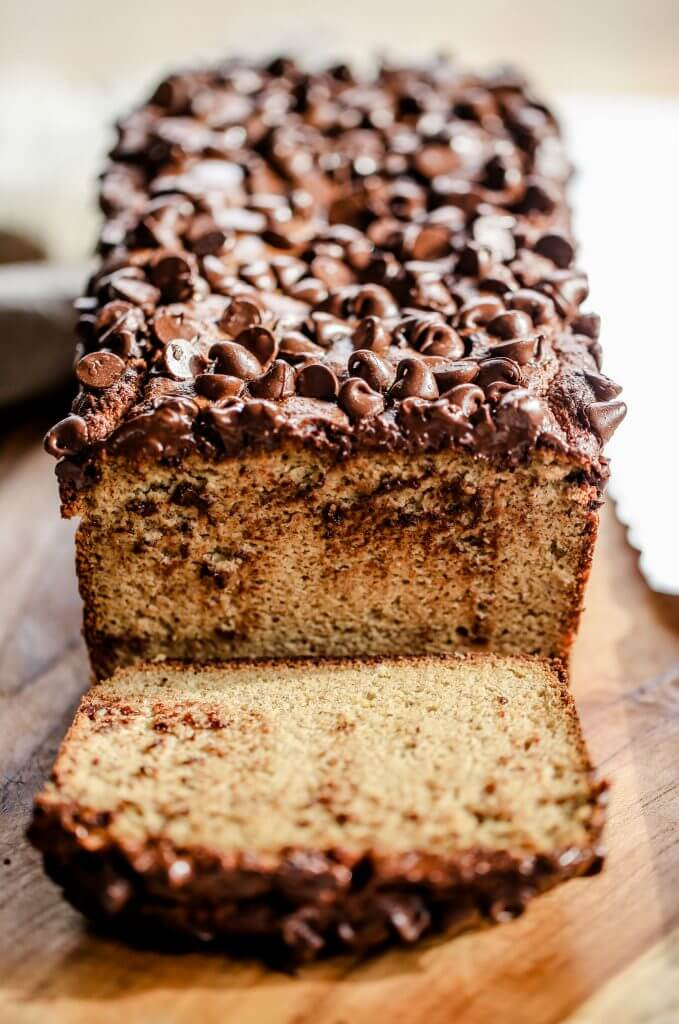 Healthy banana bread recipe made in just 5 minutes! This easy paleo gluten free banana bread has a secret healthy ingredient: cauliflower! No one ever tastes it though- and all the wheat eaters love this delicious banana bread.