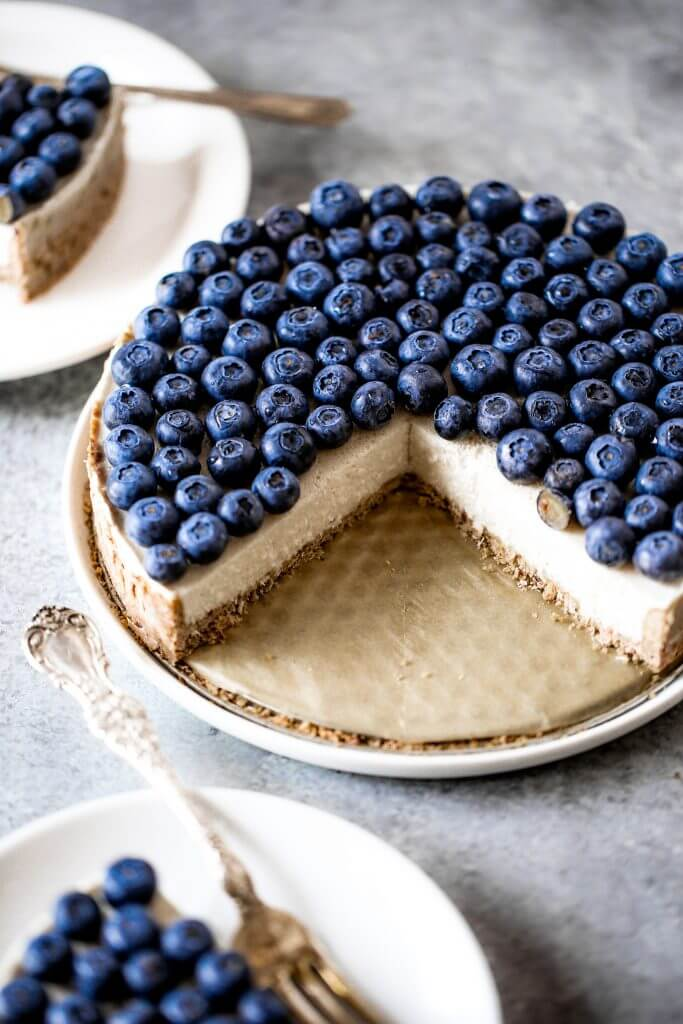 Blueberry creamy pie made with dairy-free coconut cream filling and homemade paleo coconut flour crust. Fresh and easy summer dessert topped with plenty of fresh blueberries! An easy paleo blueberry cream pie recipe. #pie #baking #recipes #paleo #cooking #dessert