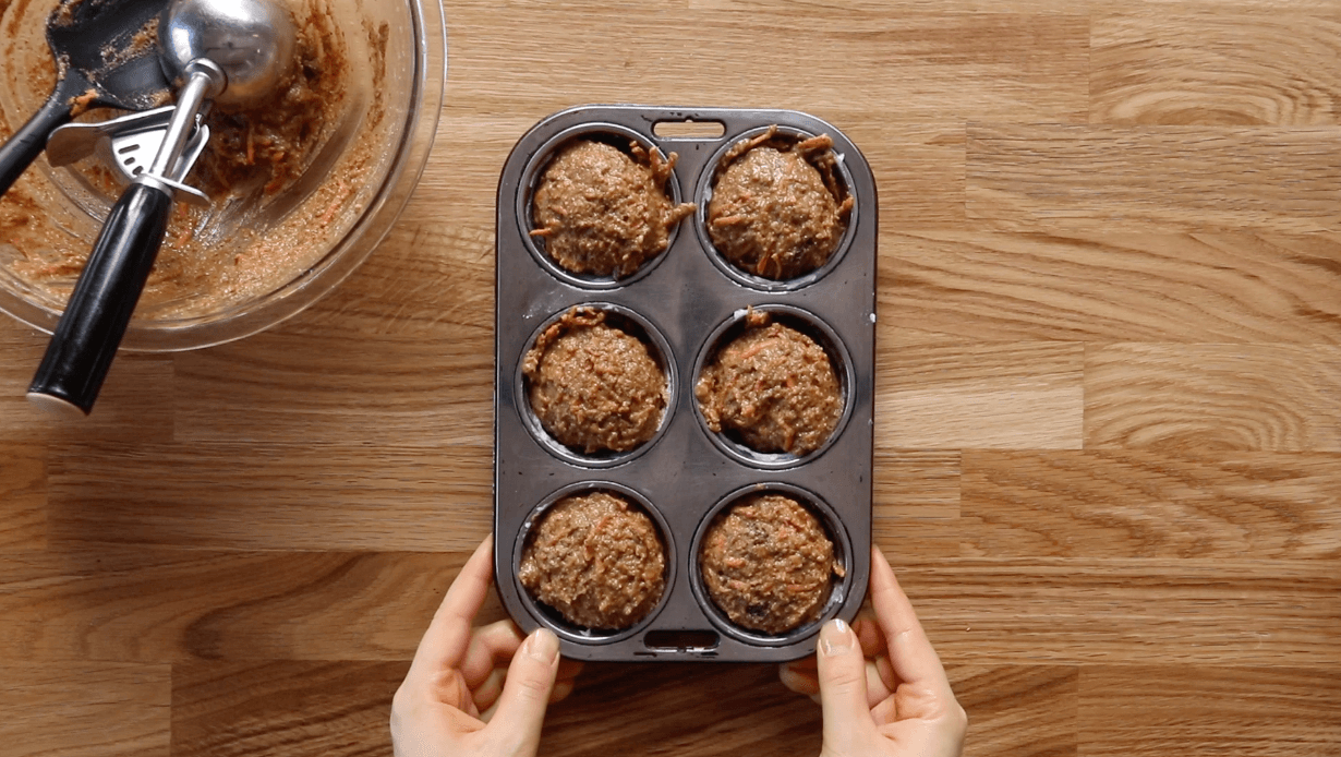 Light and healthy carrot muffins made with almond flour. Oil-free paleo muffin recipe, packed with protein and lots of yummy orange zest flavor and spices! This easy gluten-free muffin recipe is an easy family breakfast served with a side of bacon... or not. #paleo #baking #recipes #glutenfree