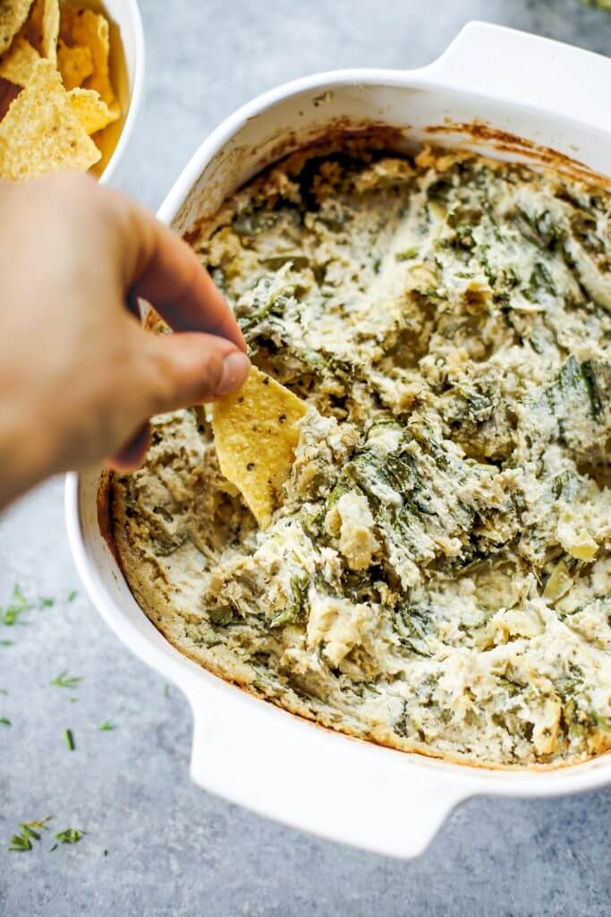 Creamy vegan artichoke dip made with cashews instead of dairy. A healthy snack and dip for veggie sticks, crackers, or bread. This paleo artichoke dip recipe is so easy to make and will keep you full and satisfied. #paleo #vegan #cooking #recipes #healthy #dairyfree