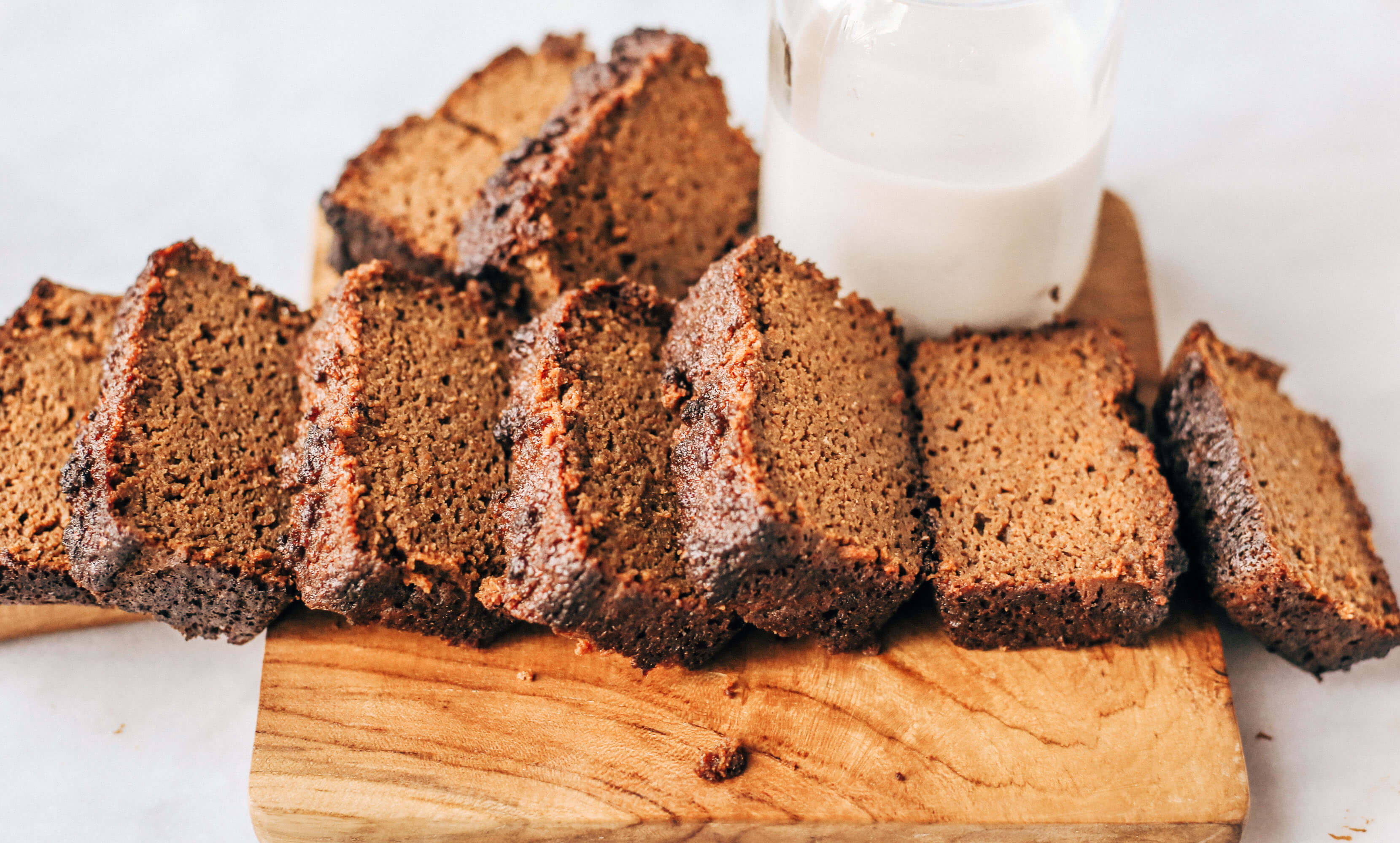 Easy recipe for healthy paleo gingerbread- made with sweet potatoes instead of flour! This loaf is such a yummy fall treat that is easy to make in a food processor. Gluten free, grain free, and dairy free gingerbread made with real ingredients. Kid approved!