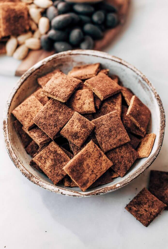 Pumpkin fall spice crackers made with sweet potatoes instead of flour! These grain free and paleo crackers are full of autumn flavors, nice and crunchy, and are perfect paired with a side of vanilla yogurt dip or served on a cheese board.