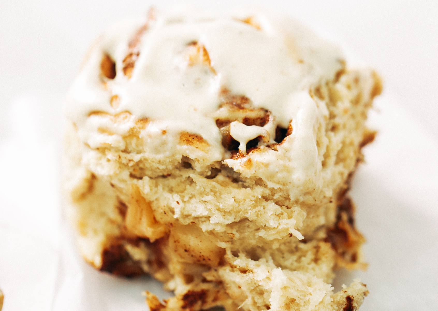 Fluffy Vegan Cinnamon Rolls made with coconut oil, almond milk, and no refined sugar! These healthier cinnamon rolls are light, fluffy, gooey, and delicious. You can make these vegan with cashew cream cheese frosting- yum!