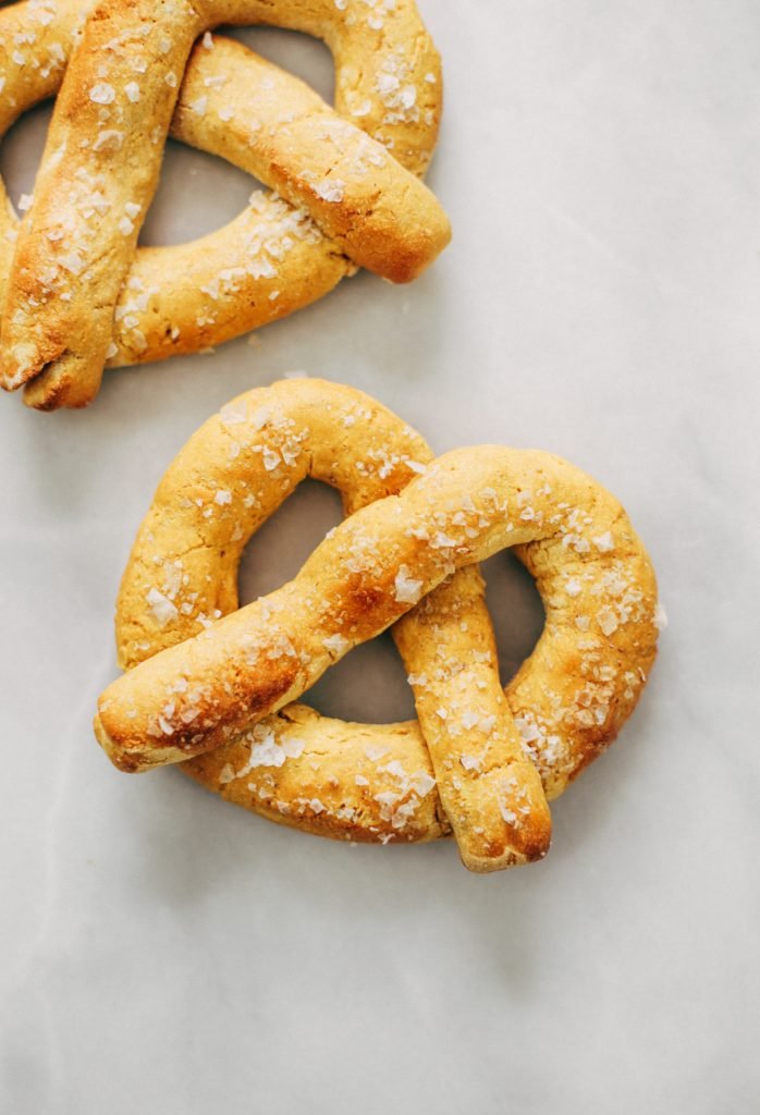 Paleo pretzels made with sweet potato! These gluten-free pretzels are easy to make and they are soft and chewy, like a real soft-baked pretzel. Can't stop eating them!